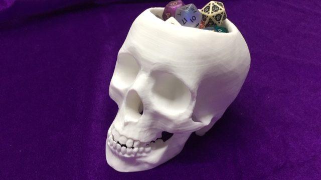 Cráneo porta dados