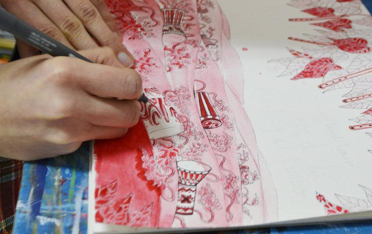 Marthazul y A.Metztli pintando la portada
