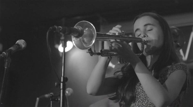 Andrea Motis with her trumpet