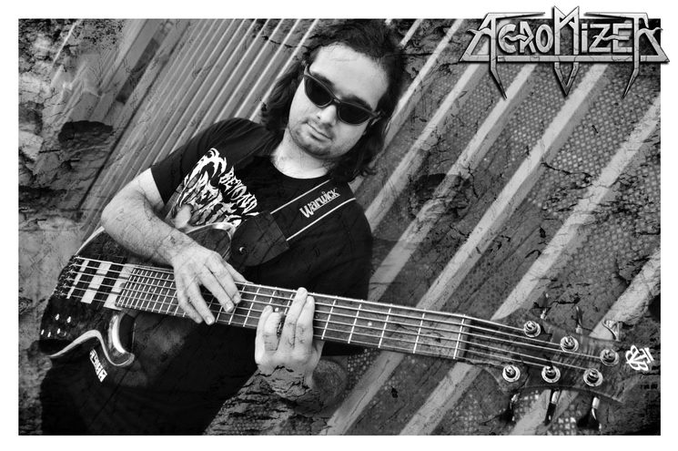Xavi - Bass guitars and chorus singer