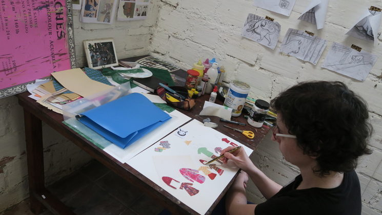 Silvia drawing in her workshop