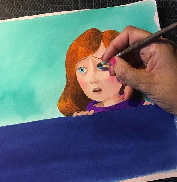 Yolanda Cabrera trabajando en las ilustraciones