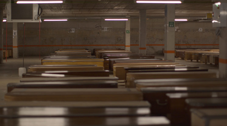 Still of Barcelona graveyard that received so many corpses they had to restructure the car garage to put in the coffins, March 2020