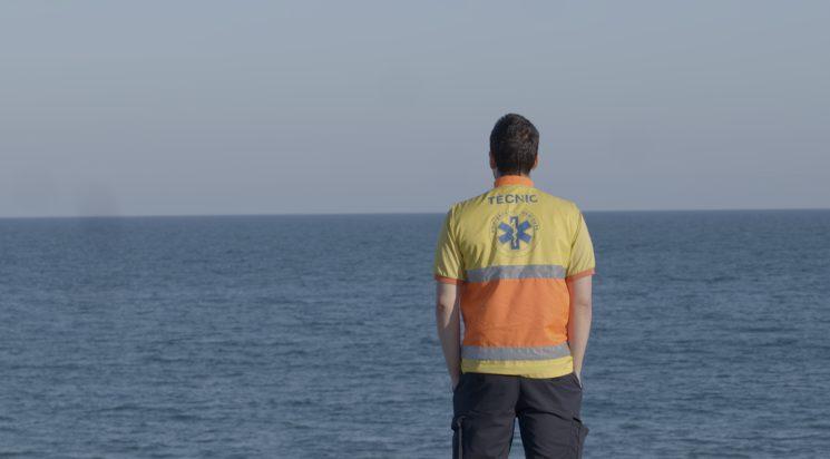 Ambulance driver gazing at the horizon, March 2020