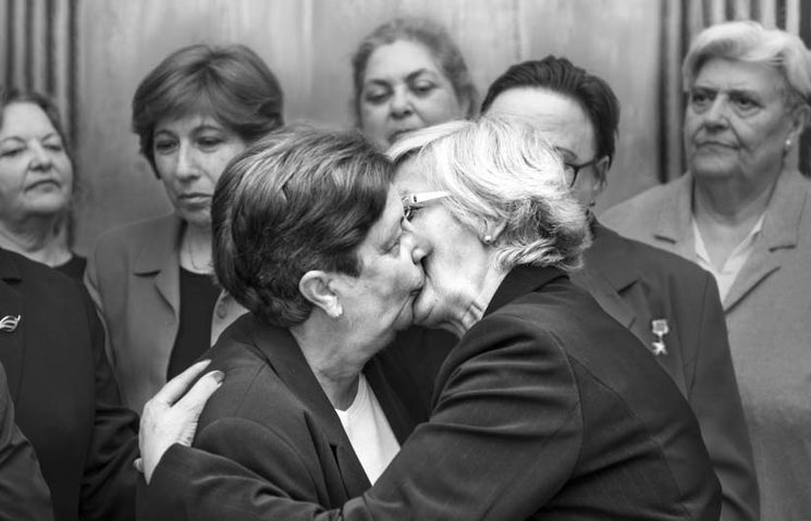 "The fraternal ""socialist kiss"" between Lyudmila Brezhnev and Erica Honecker, 1979."